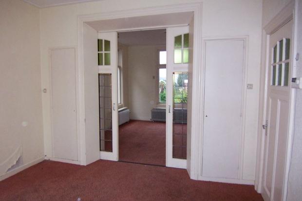 Pastoriewoning Nieuwe Pekela woonkamer deuren go with the vlo