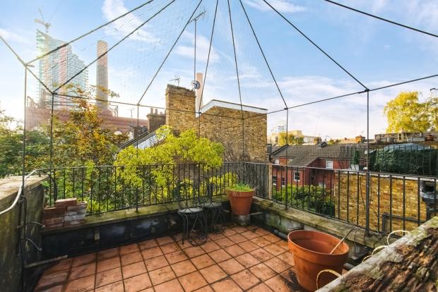 Binnenkijker Londen huis balkon Henry Wilson go with the vlo